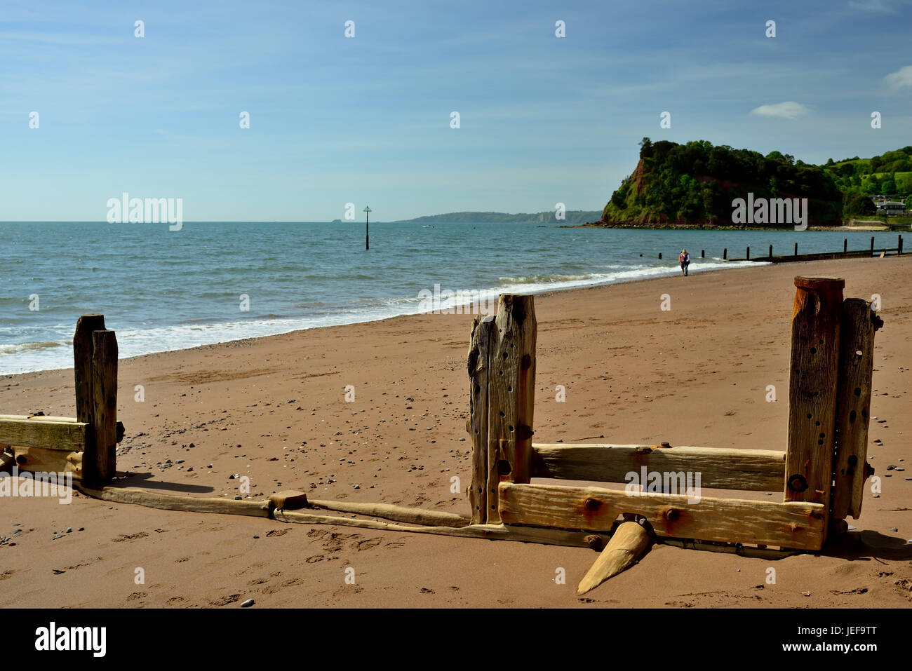 Deteriorating groynes on the beach, looking towards the Ness. - Stock Image