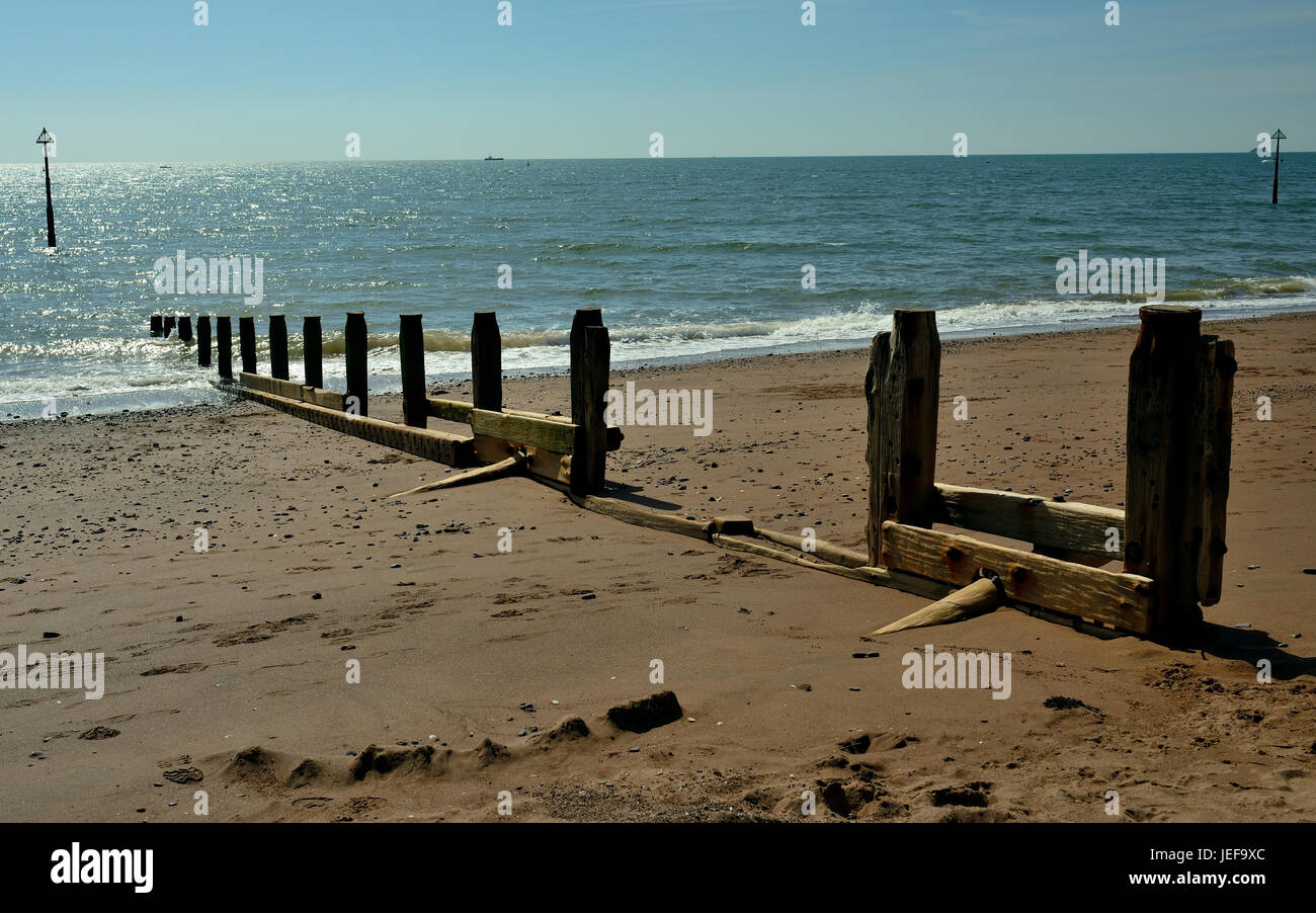 Deteriorating groynes on the beach - Stock Image