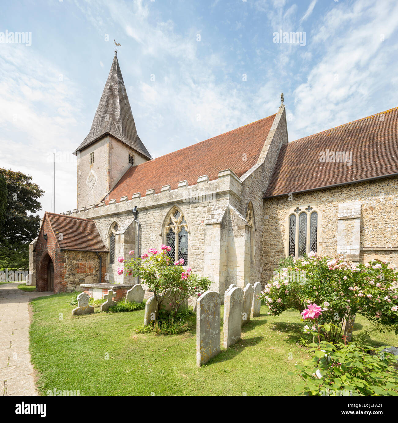 The Holy Trinity Church in the attractive coastal village of Bosham, West Sussex, England, UK - Stock Image