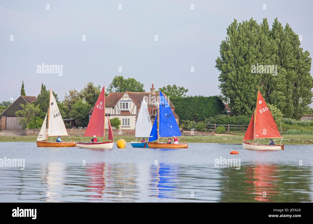 Sailing by the  attractive coastal village of Bosham, West Sussex, England, UK Stock Photo