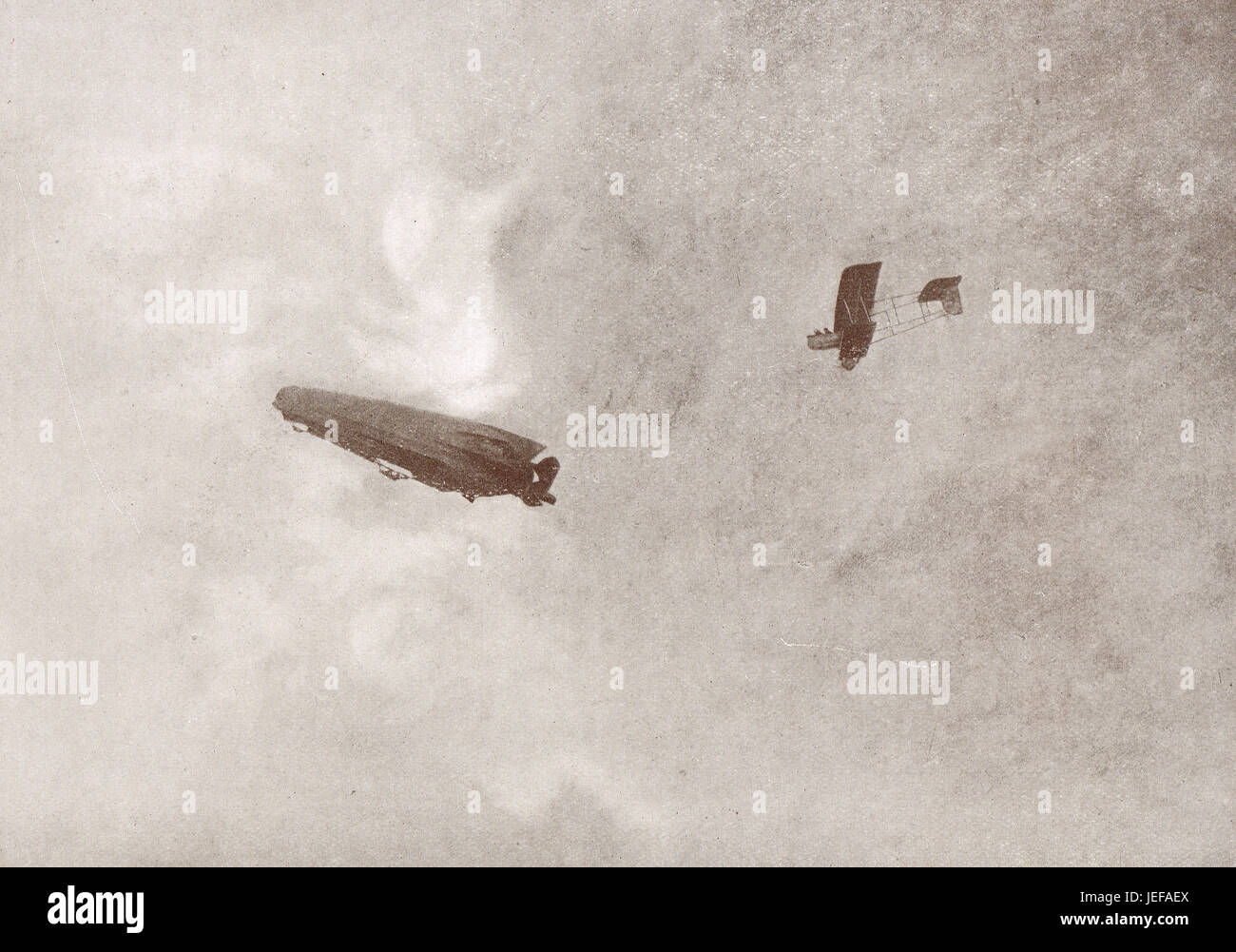 French Aeroplane pursuing a Zeppelin that has just bombed Paris, March 1915 - Stock Image