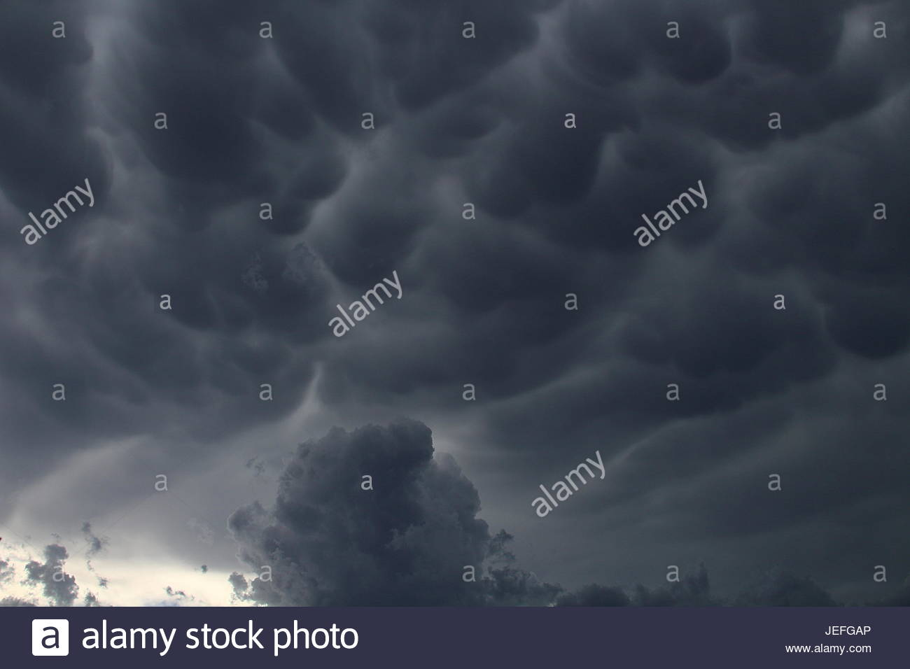 Mammatus clouds rolling across the New Mexico desert - Stock Image
