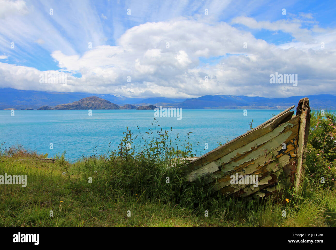 Boat on shore of General Carrera Lake with islands, Patagonia, Chile Stock Photo