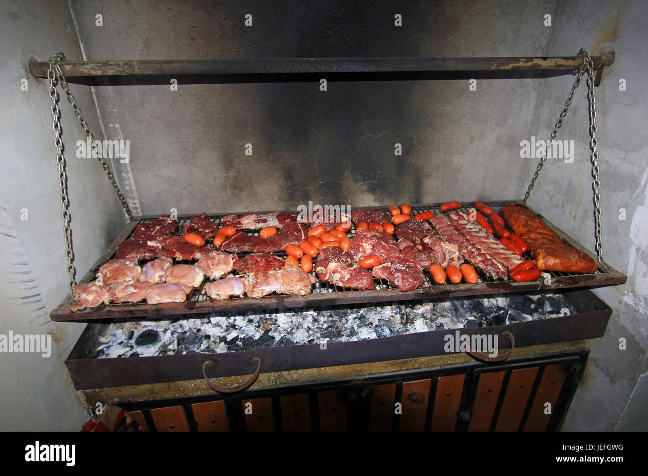 Typical argentinean parillada BBQ in Argentina or Chile - Stock Image