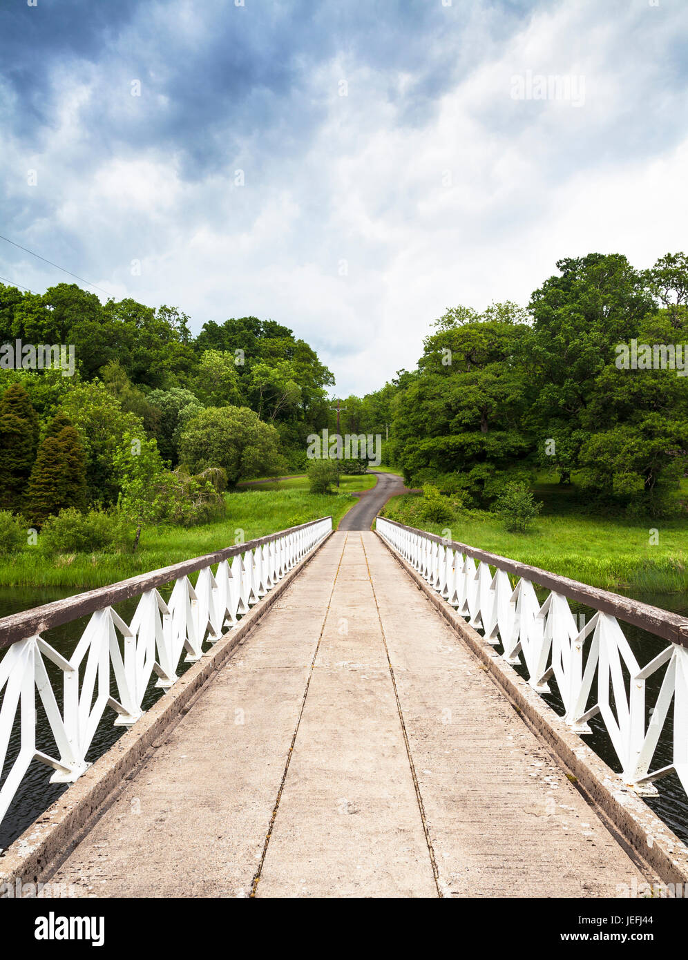 The bridge to one of the islands at Crom Castle situated on the shores of the Upper Lough Erne, County Fermanagh, - Stock Image