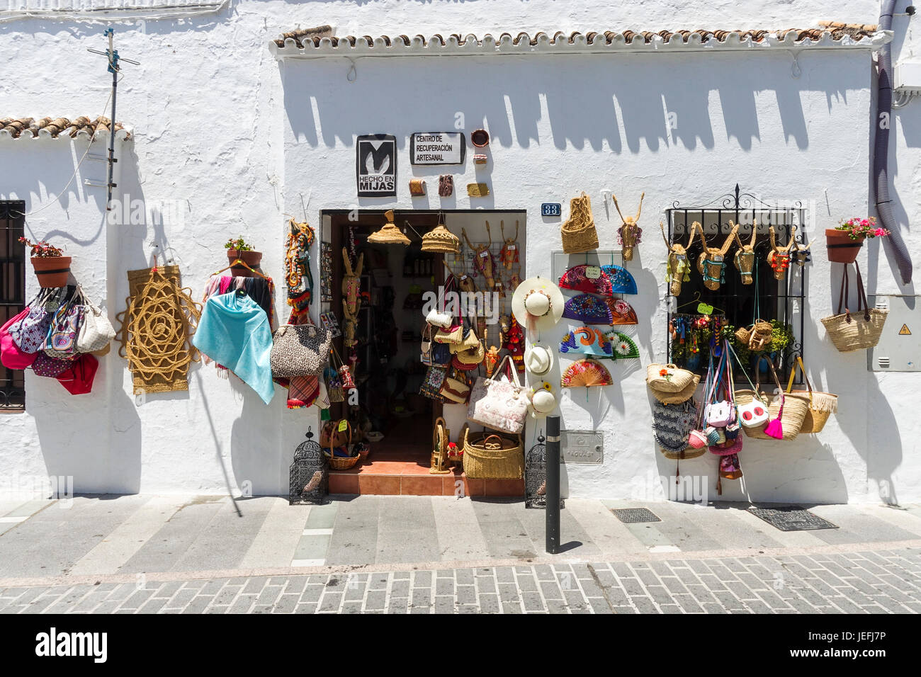 Souvenir shop selling local artisinal products in the white village of Mijas, andalusia, Spain. Stock Photo