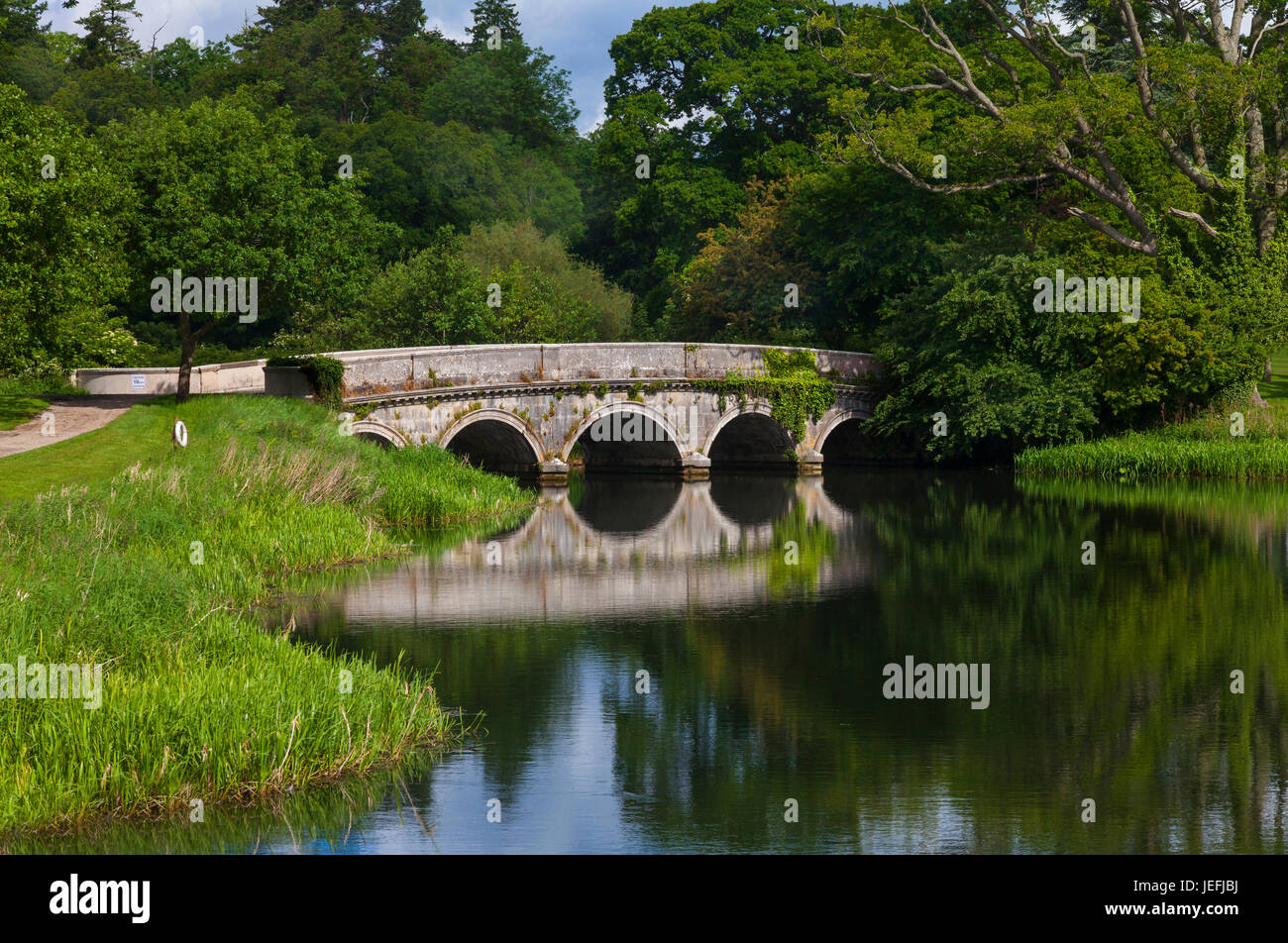Bridge over the River Rye part of the finest example in Ireland of a Georgian-created parkland landscape. Carton - Stock Image