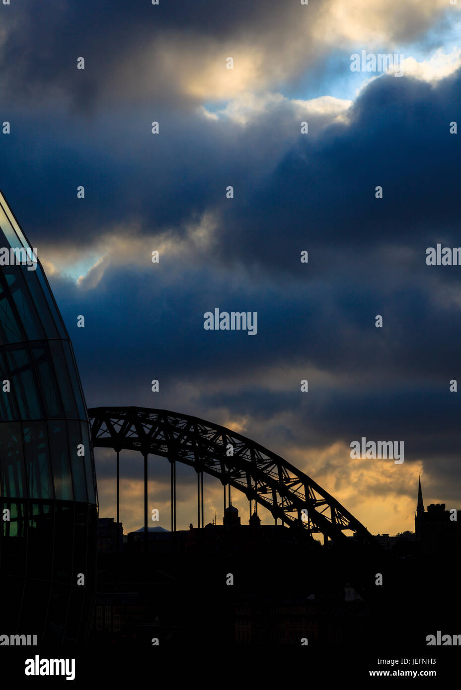 Newcastle Silhouette.  The Sage Centre and the Tyne Bridge silhouetted against the Newcastle skyline in North East Stock Photo