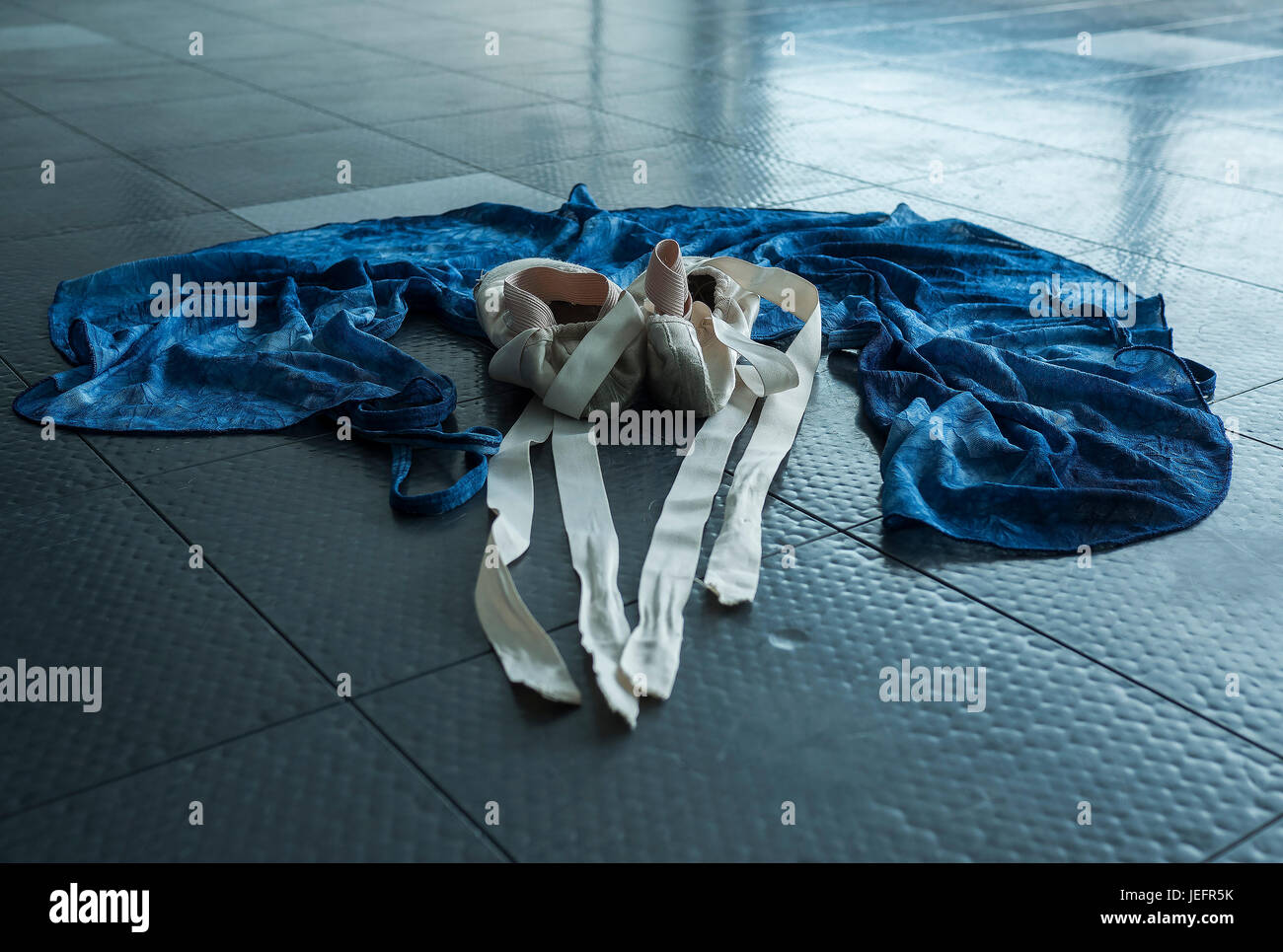 A ballet dancer's ballet pointe shoes and her practice wrap skirt - Stock Image