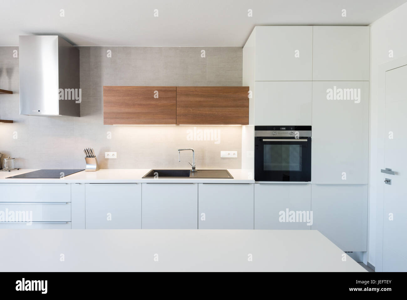 Modern Kitchen Interior With With Built In Appliances Stock Photo