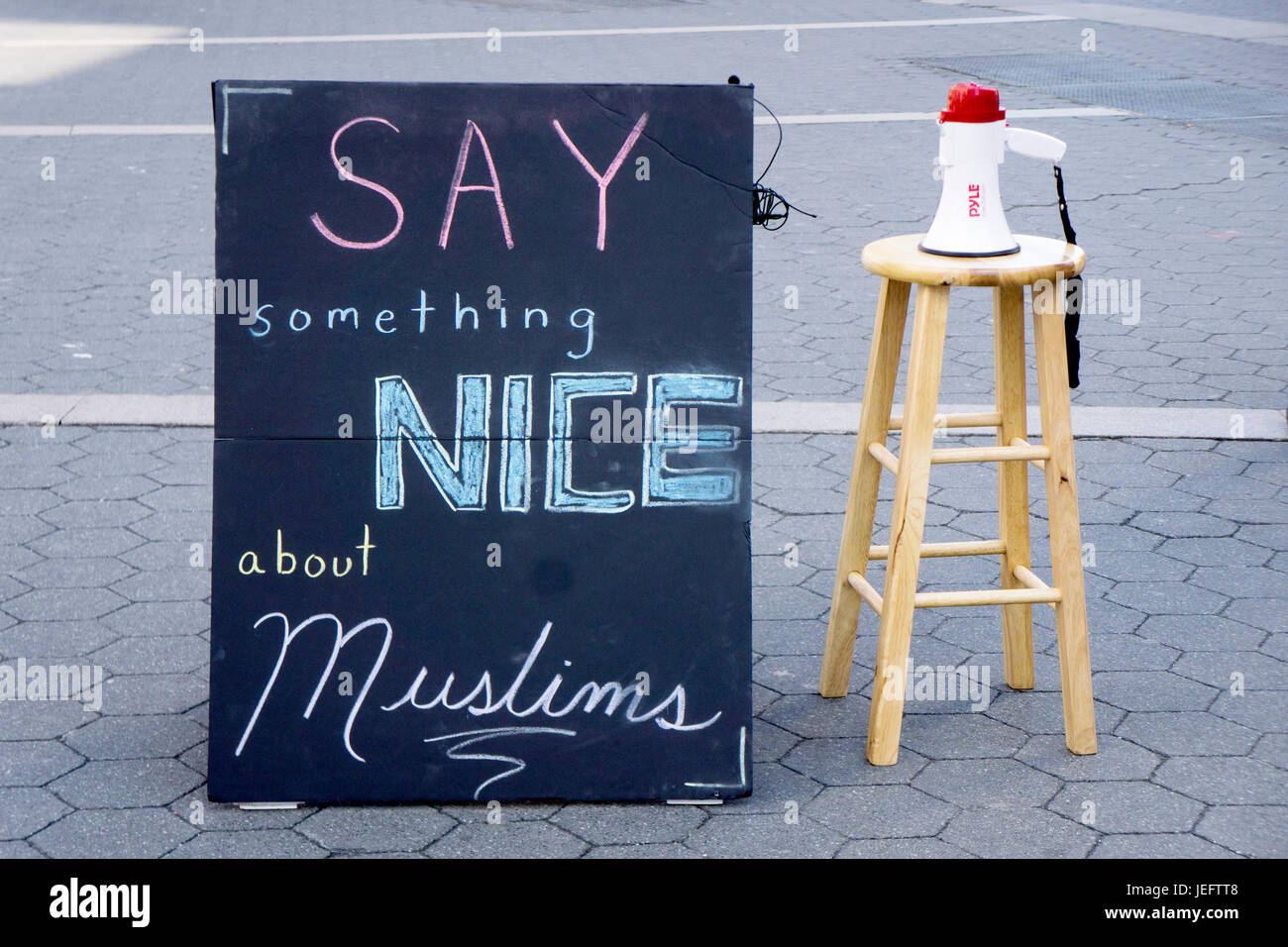 A sign and megaphone from a campaign to promote understanding of Muslims. In Union Square Park, Manhattan, New York - Stock Image