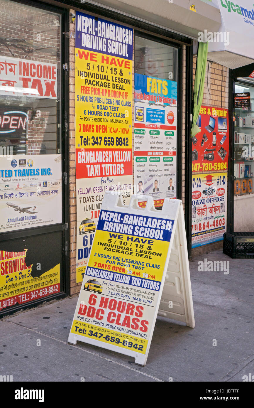 Bilingual advertising signs in an alleyway off 75th st. in Jackson Heights, Queens, New York City. - Stock Image