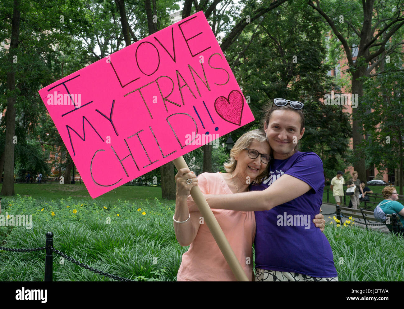 A mother with a sign supporting her transgender daughter at the Trans Day of Action rally in Washington Square Park - Stock Image