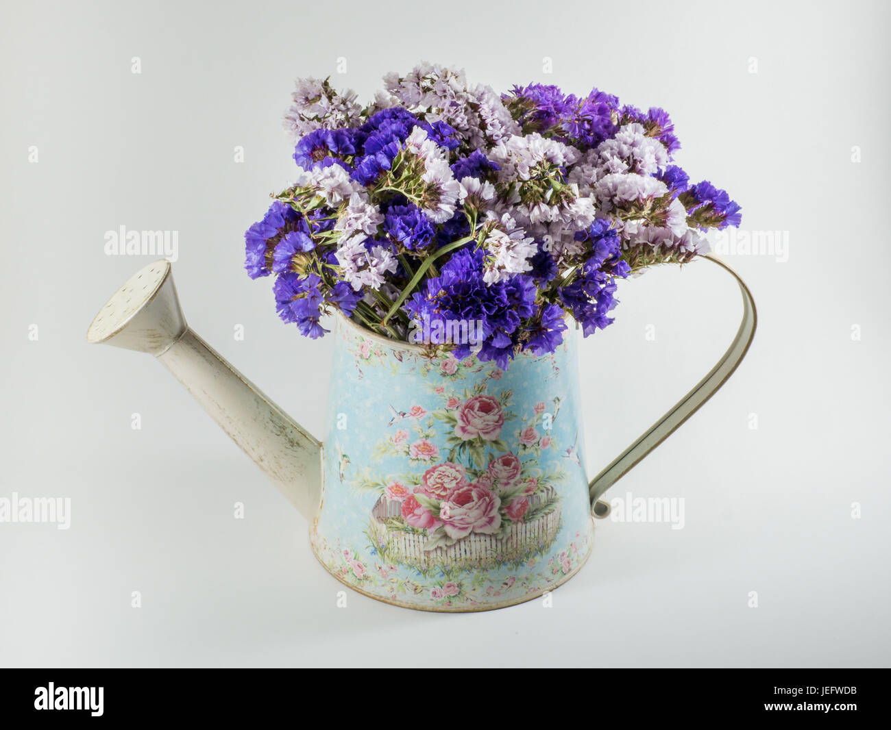 Bouquet of dried flowers inside a vintage metal watering can stock bouquet of dried flowers inside a vintage metal watering can izmirmasajfo Images