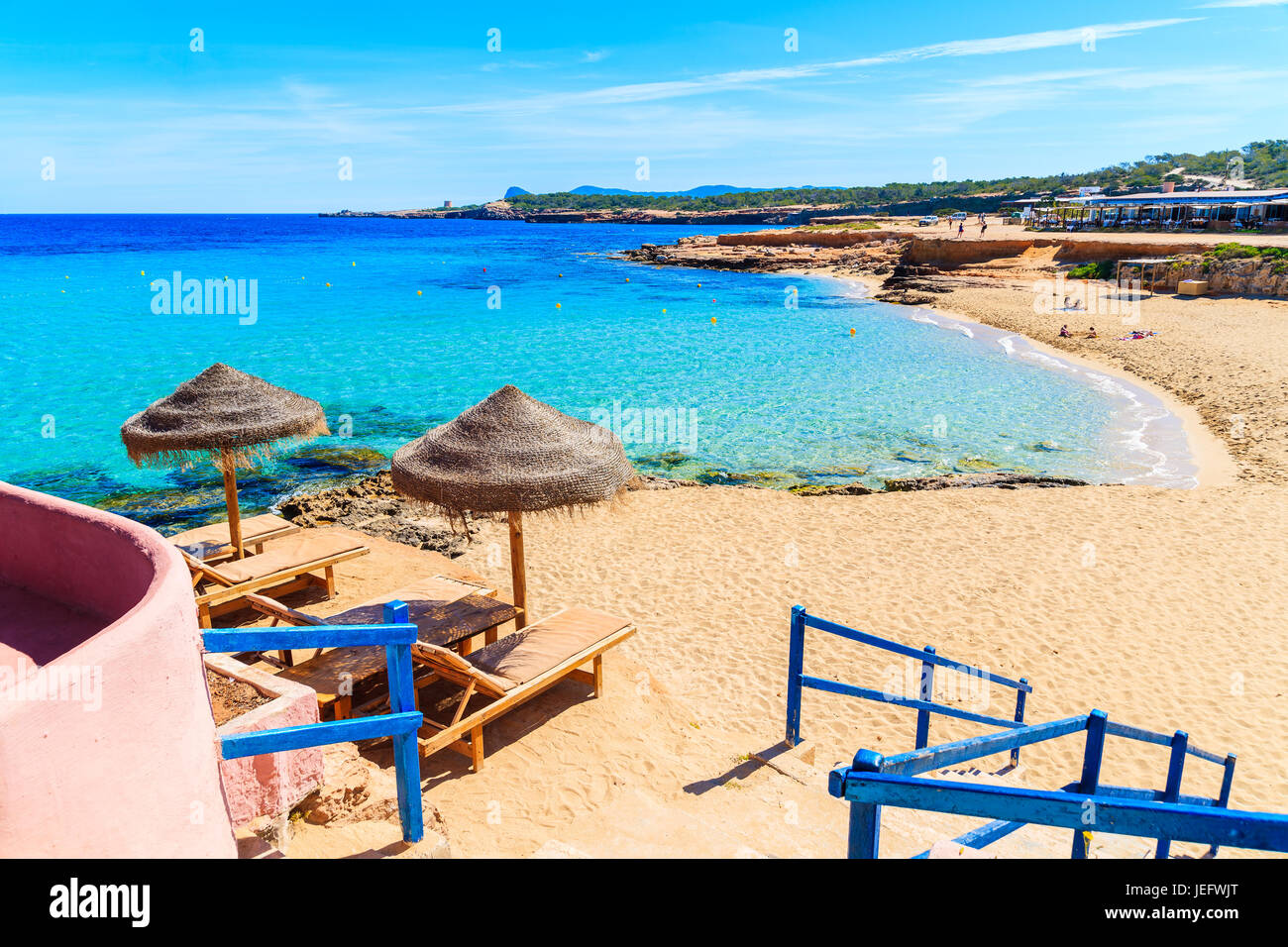 Steps from coastal bar to Cala Comte beach, Ibiza island, Spain - Stock Image