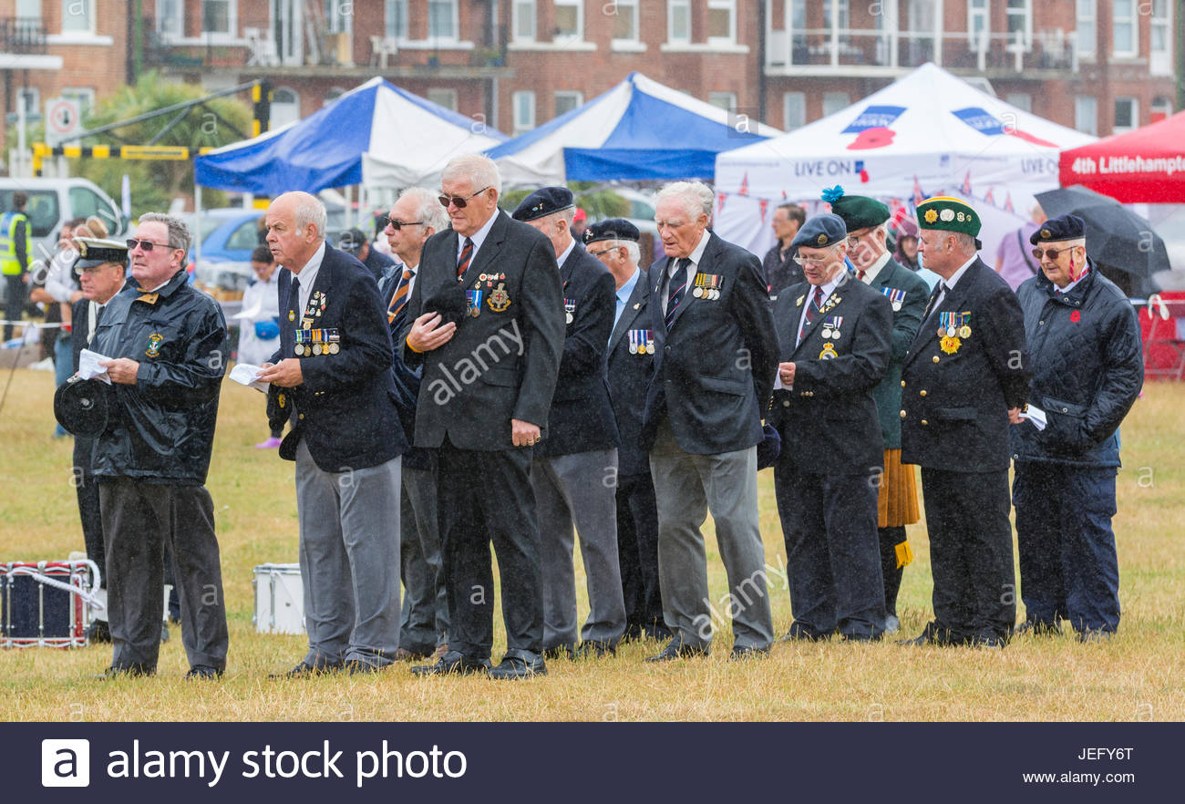 Veteran military men standing in the rain at the morning service at the June 2017 Armed Forces Day event in Littlehampton, - Stock Image