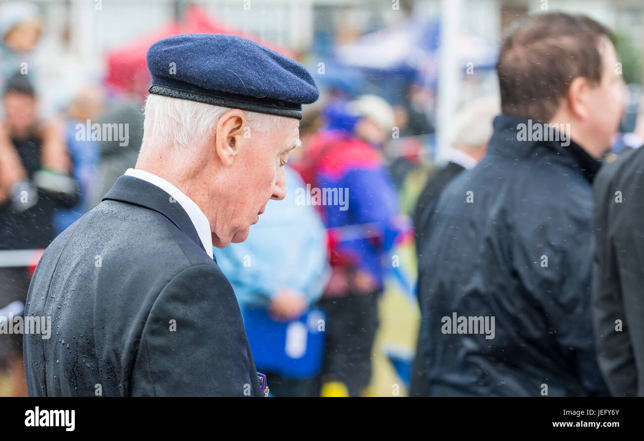 Veteran military officer bowing his head in prayer during the service at the 2017 Armed Forces Day event in Littlehampton, - Stock Image