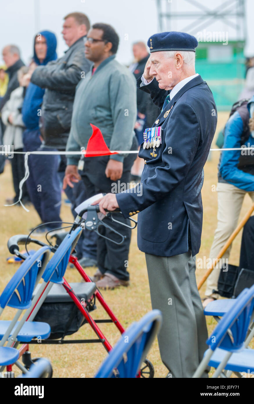 Veteran military officer giving a salute at the 2017 Armed Forces Day in Littlehampton, West Sussex, England, UK. - Stock Image