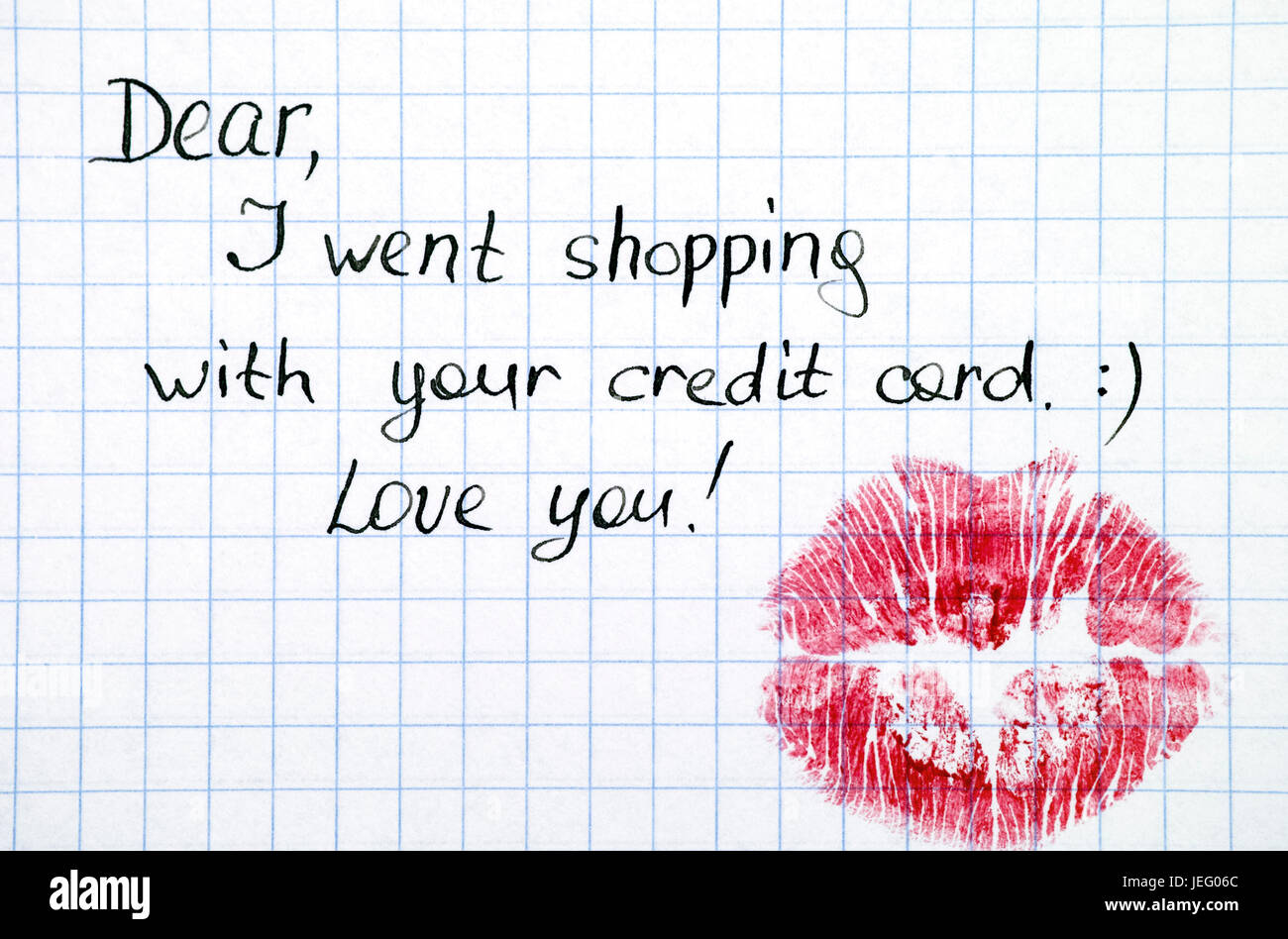 Note - Dear, I went shopping with  your credit card. Love you! with kiss. - Stock Image