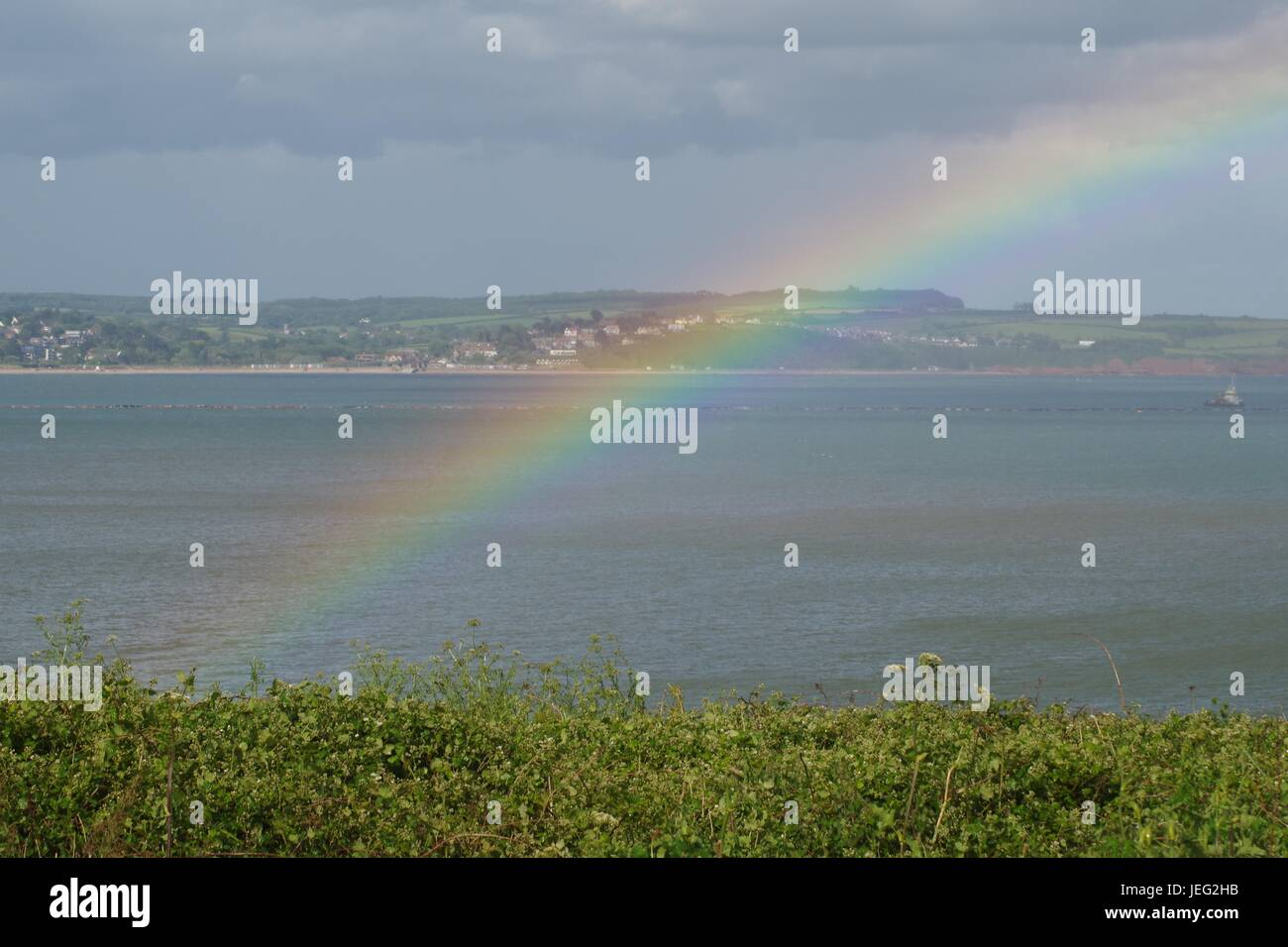 Rainbow Over the English Channel from Langstone Rock, Dawlish, UK. June, 2017. - Stock Image