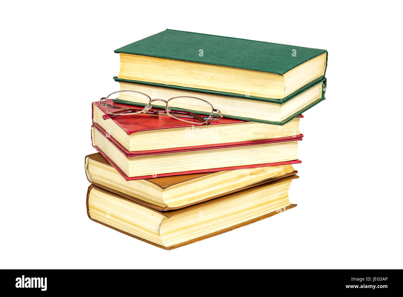 on a pile of hard bound books lie reading glasses stock photo