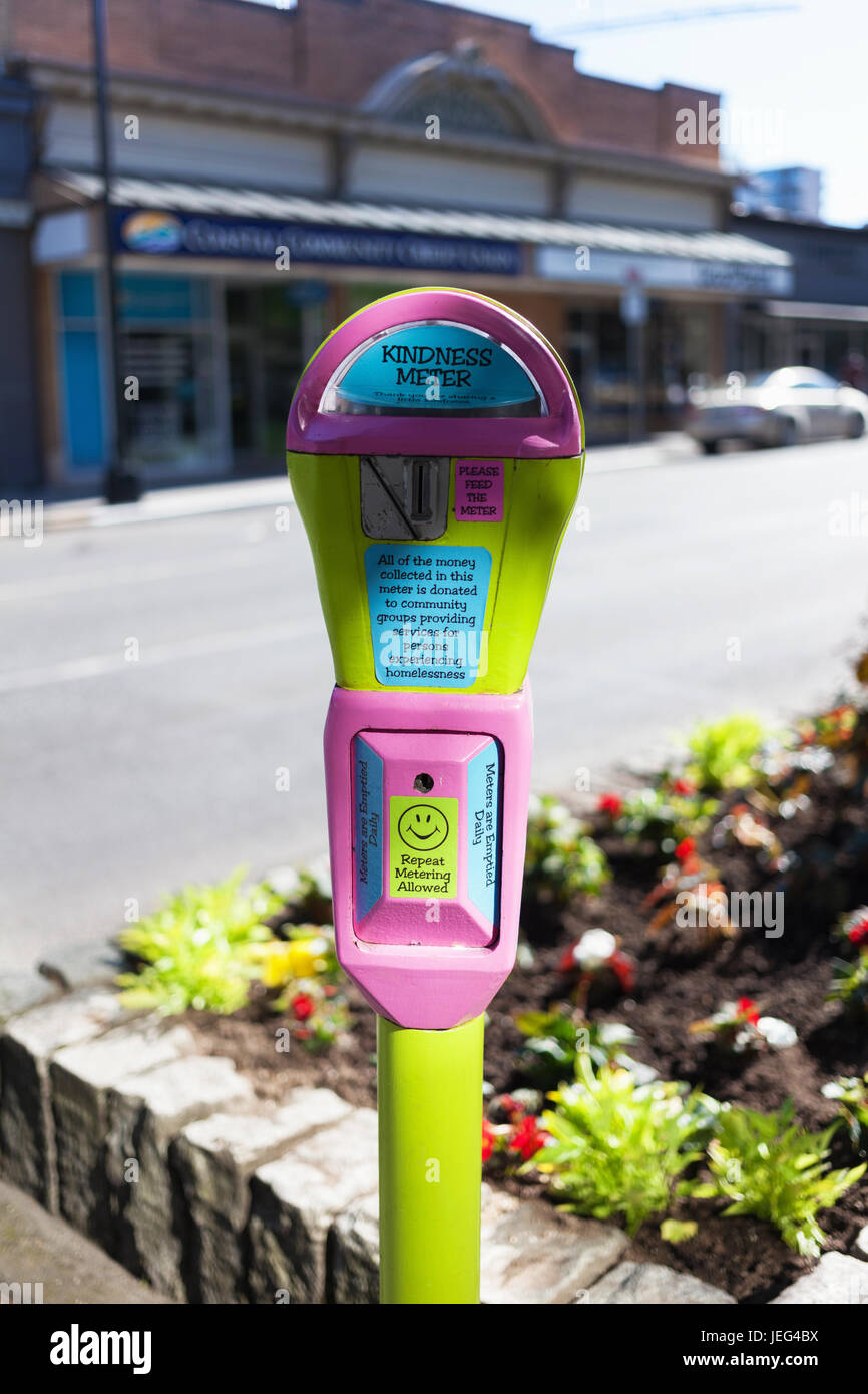 Pink and yellow kindness meter to help with homelessness.  Victoria, BC, Canada - Stock Image