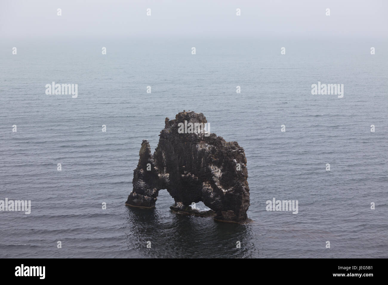 Hvitserkur is a spectacular rock in the sea on the Northern coast of Iceland. Bad weather Stock Photo