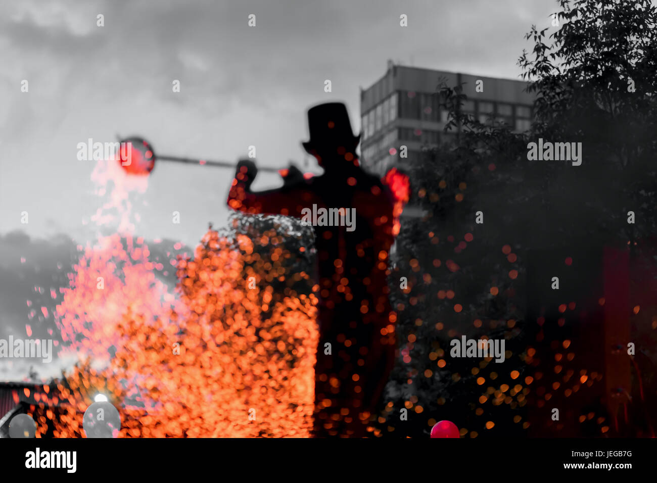 Amazing Fire Show at night. Silhouette of master fakir with fire works. Dance of fire performance, magic concept - Stock Image