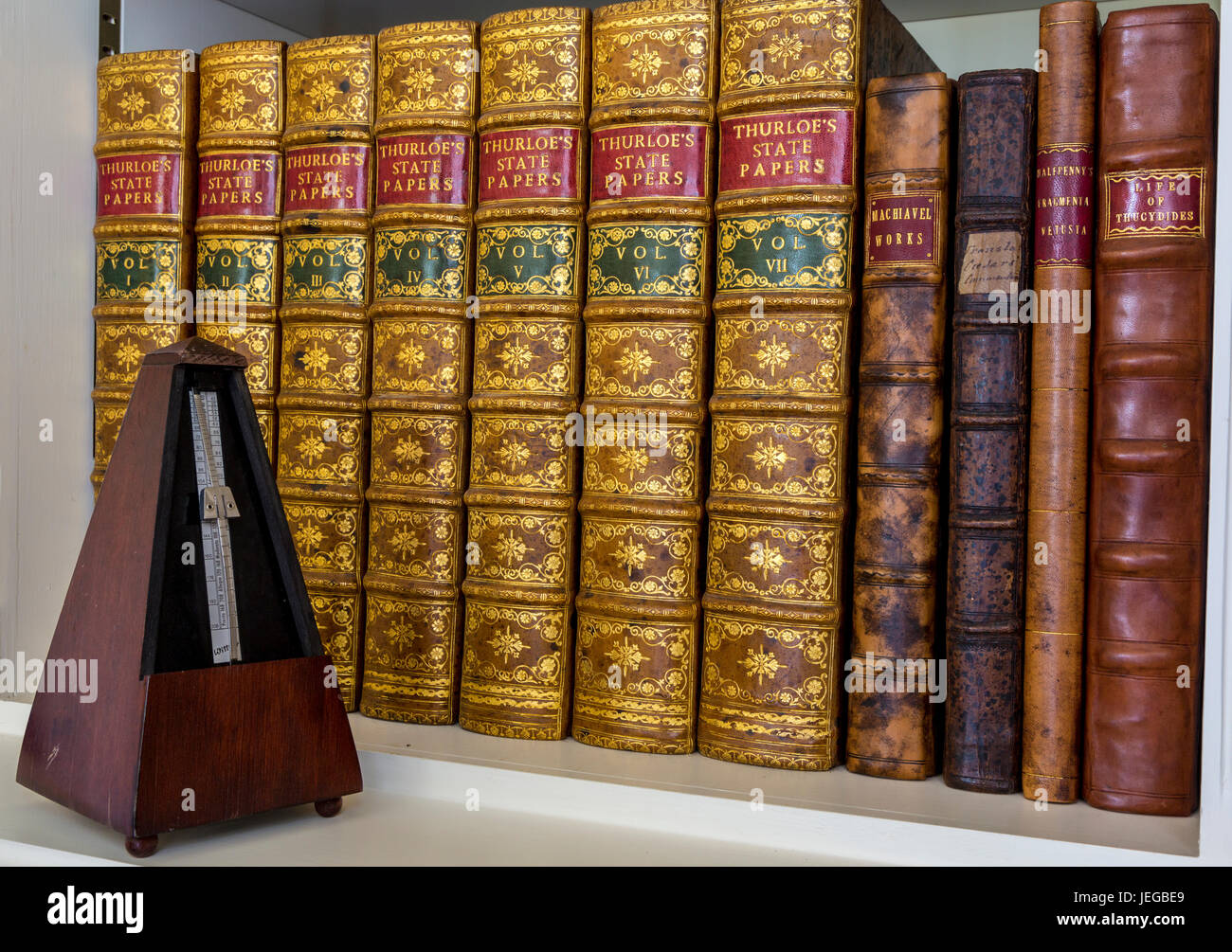 Yorkshire, England, UK.  Antiquarian Books in Library of a Country Estate.  Thurloe's State papers and metronome. - Stock Image