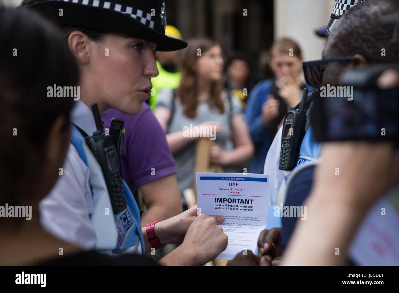 London, UK. 24th June, 2017. Police officers explain restrictions applicable under Sections 12 and 14 of the Public Stock Photo
