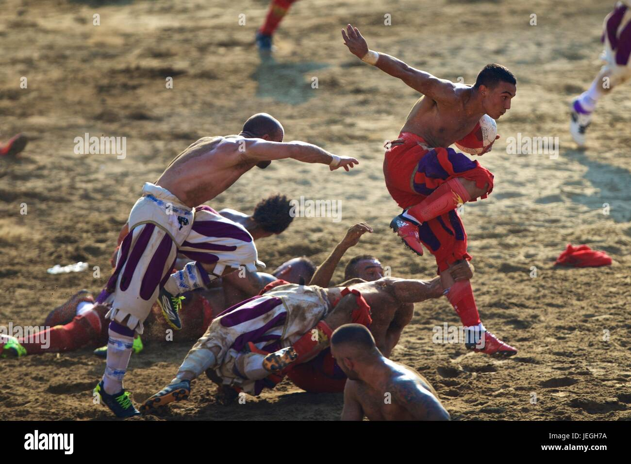 Florence, Italy. 24th June, 2017. Players compete during the final match of the Calcio Storico Fiorentino traditional Stock Photo
