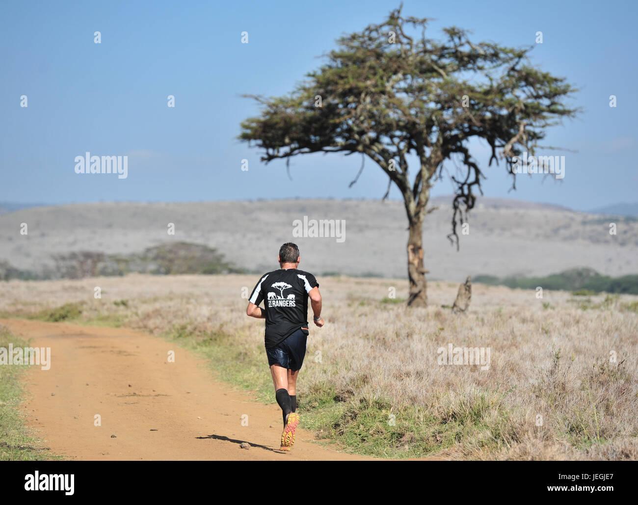 Nairobi. 24th June, 2017. A runner competes during the 2017 Safaricom Lewa Marathon at northern Kenya's Lewa Wildlife Stock Photo