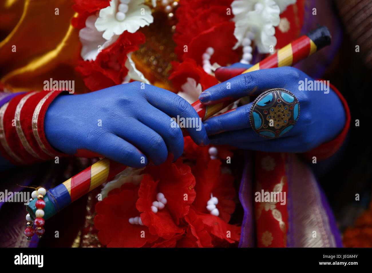 Kathmandu, Nepal. 25th June, 2017. Hands of a Nepalese person dressed as Hindu Deity Krishna are pictured as they Stock Photo