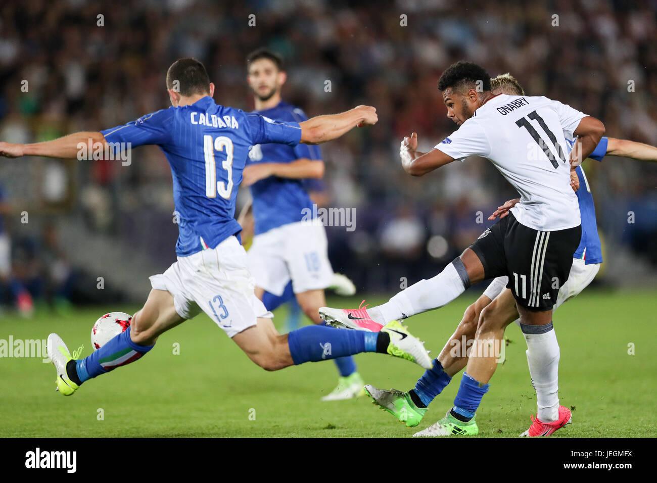 Cracow, Poland. 21st June, 2017. Italian Mattia Caldara (L) foils an attempt on the Italian goal by German player - Stock Image