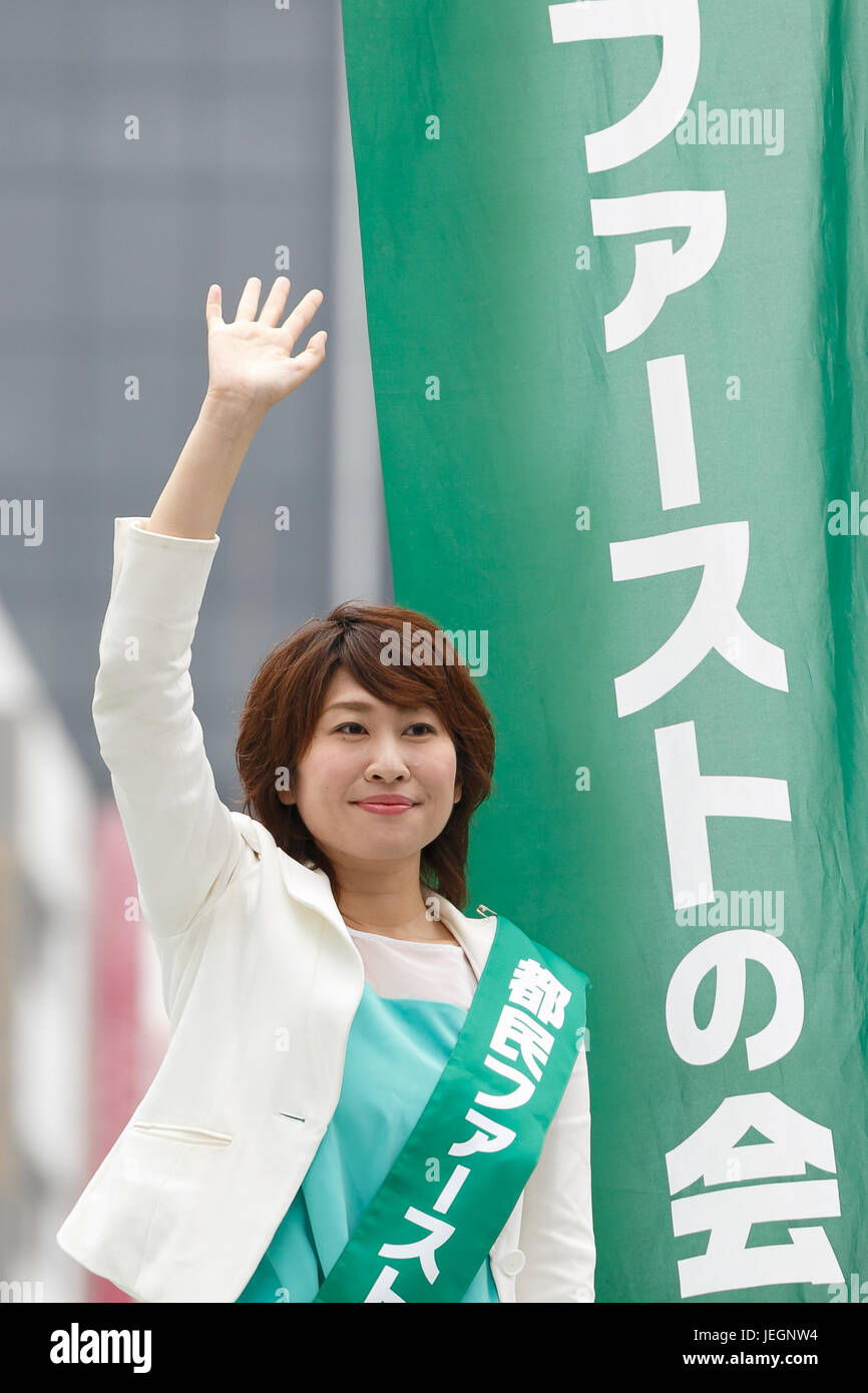 Candidate Ayumi Saigo waves to supporters during a campaign event for Tokyo's Metropolitan Assembly election - Stock Image