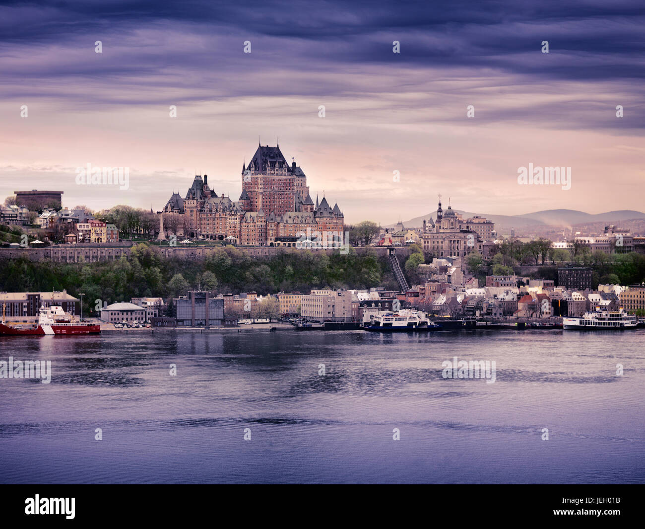 Old Quebec City and port skyline at dusk with Château Frontenac, view over the St. Lawrence river, Quebec, - Stock Image