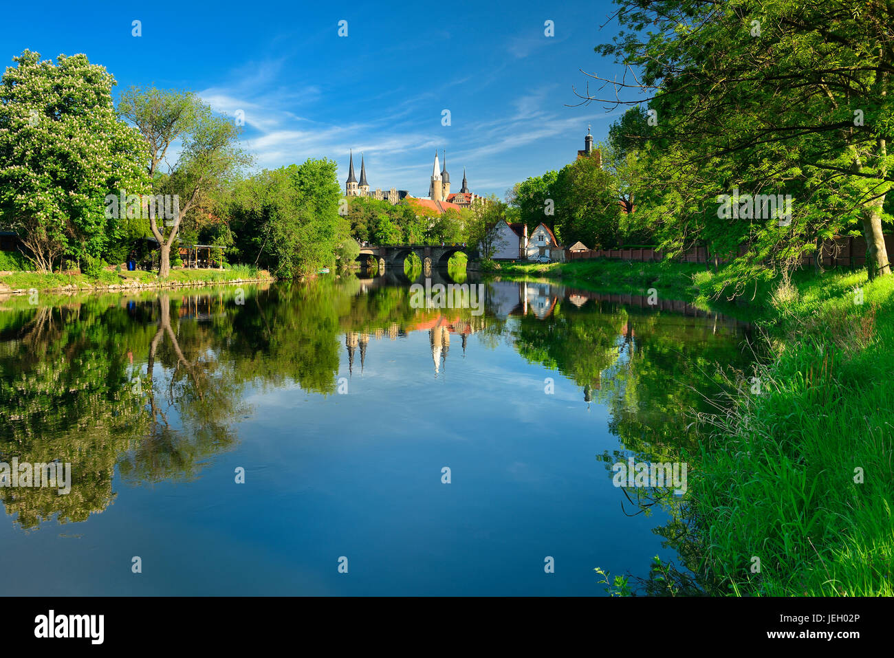 Merseburg Cathedral and Merseburg Castle are reflected in the River Saale, Merseburg, Saxony-Anhalt, Germany - Stock Image