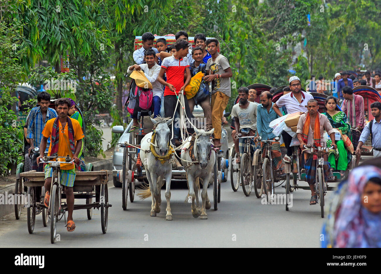 In their desperate bid to leave the capital to celebrate Eid with family members, people travel on horse court to - Stock Image