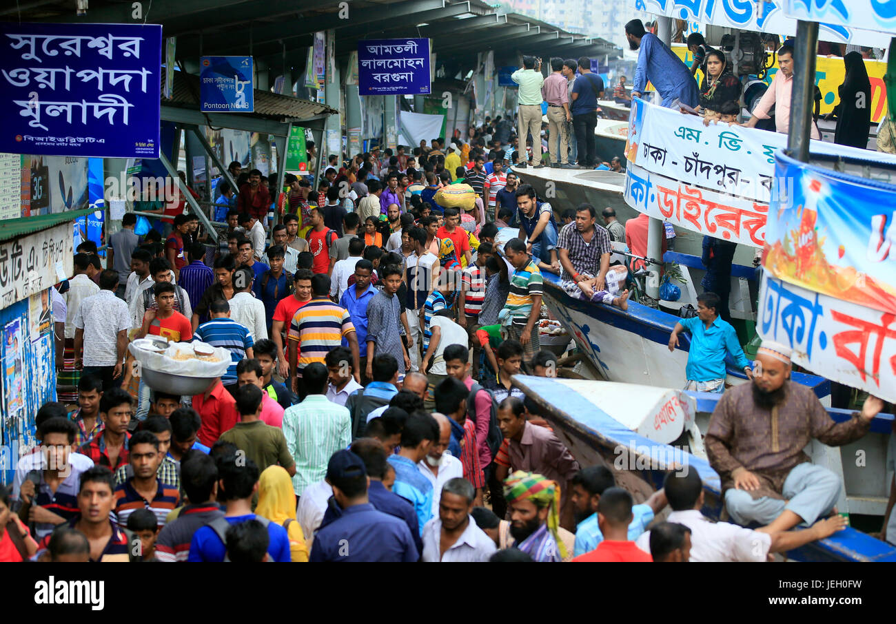Passengers ready to board launches at Sadarghat Launch Terminal. Thousands of people have started leaving the capital - Stock Image
