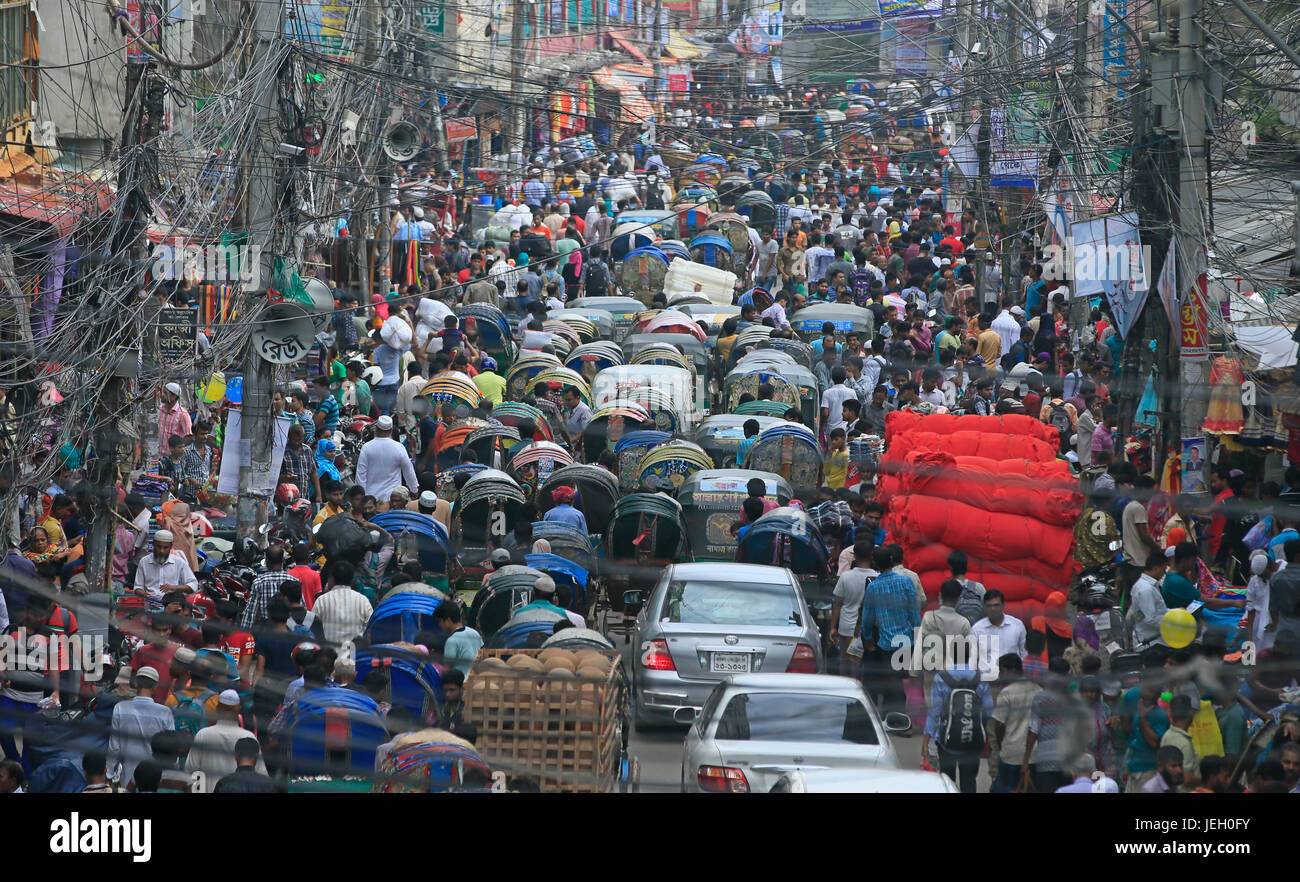 People crowd a street through the Sadarghat Launch Terminal in the capital while the ahead of Eid. June 24, 2017, - Stock Image