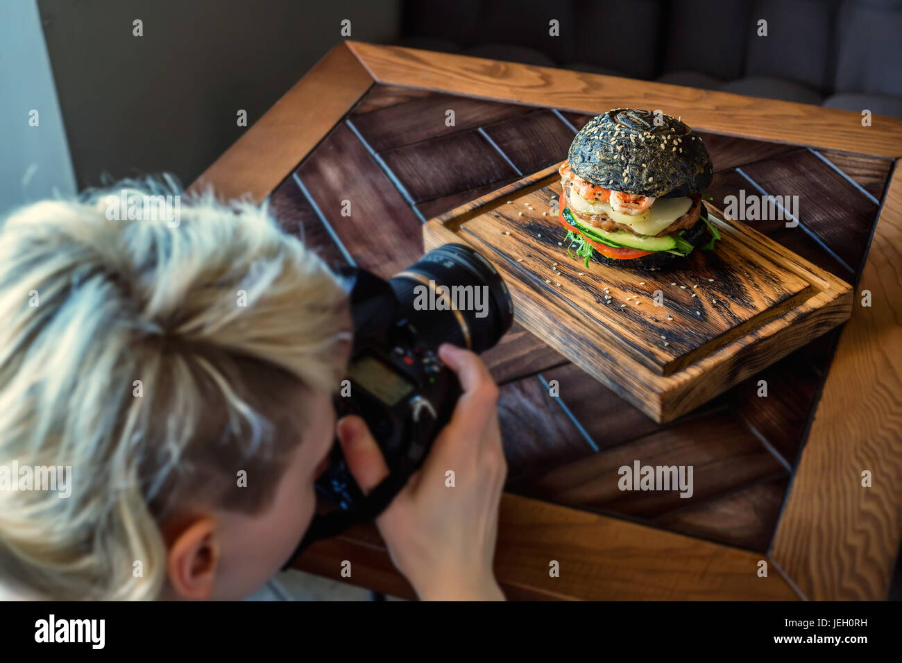 Occupation of food photographer - Stock Image