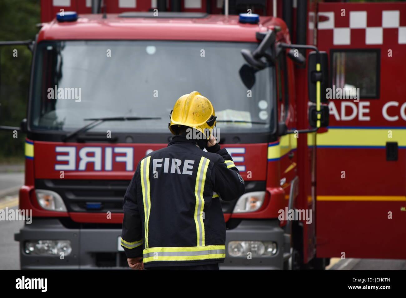 London Fire Brigade Firefighter Walking Towards a Fire Appliance - Stock Image