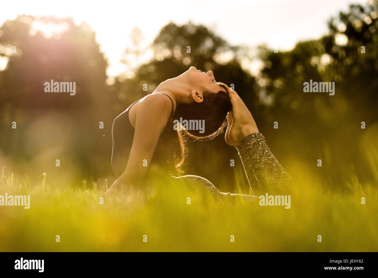 yoga woman on green park - Stock Image