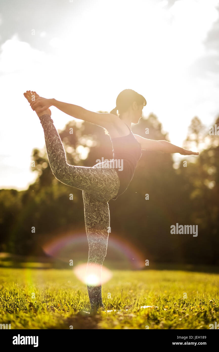 Caucasian woman in yoga standing balance Natarajasana. Back view - Stock Image