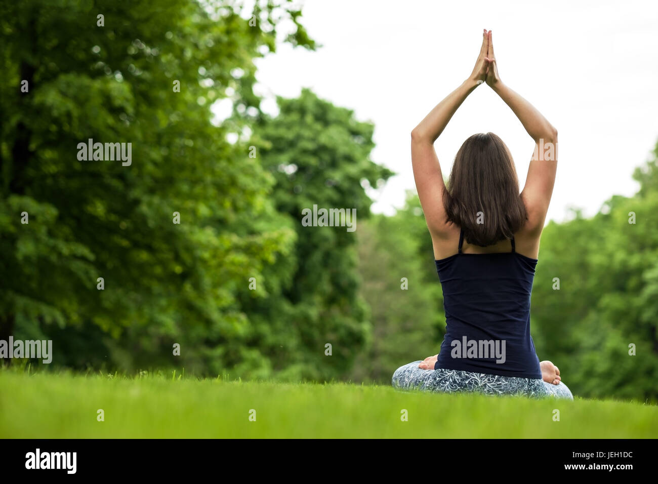Meditation healthy life exercise concept. meditating and relaxing in Padmasana Lotus Pose - Stock Image