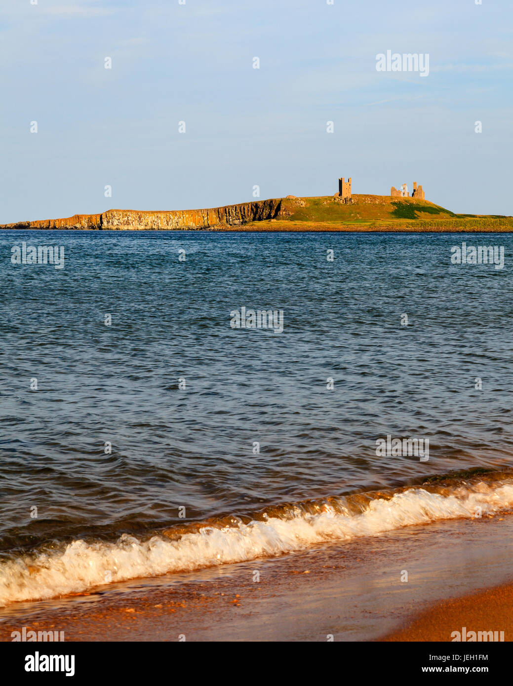 Dunstanburgh Castle.  Dunstanburgh is a medieval castle located in Northumberland, North East England and dates - Stock Image