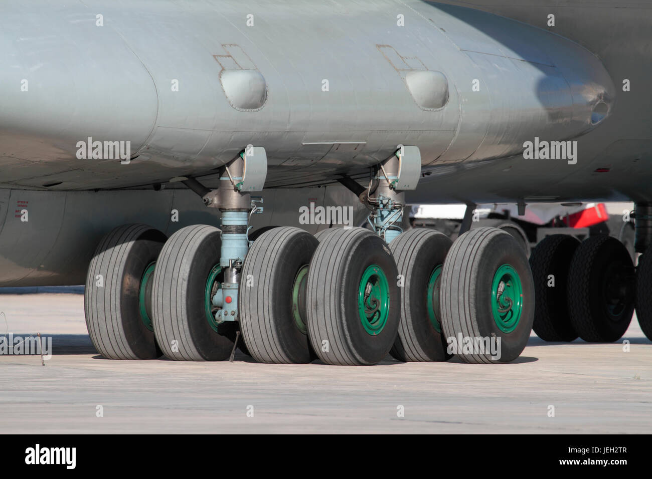 Right main undercarriage of an Ilyushin Il-76 cargo plane, showing twin undercarriage legs with four wheels on each - Stock Image