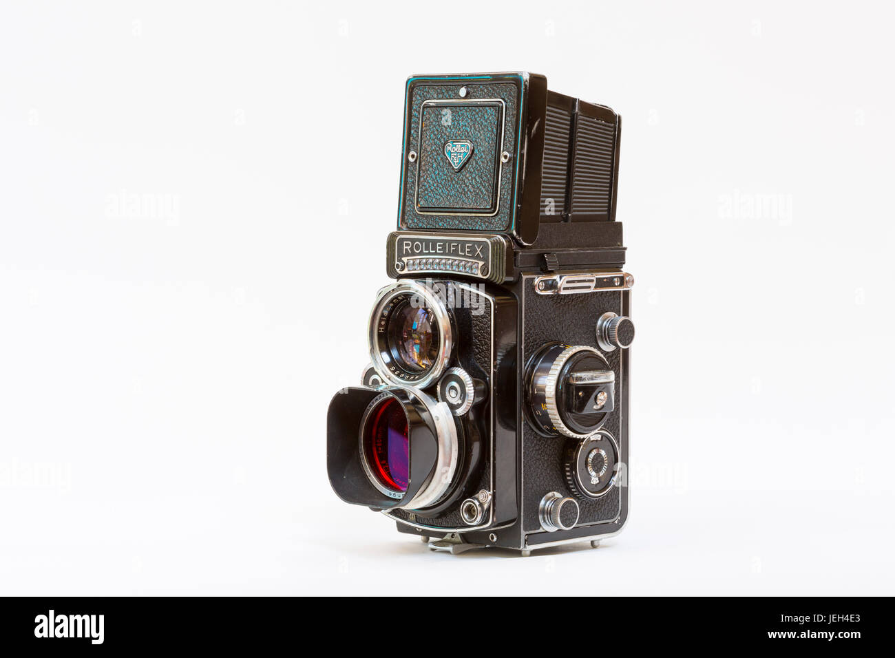 1960's Rolleiflex 2.8F twin lens reflex camera with an orange filter on the taking lens. A popular camera with professional Stock Photo