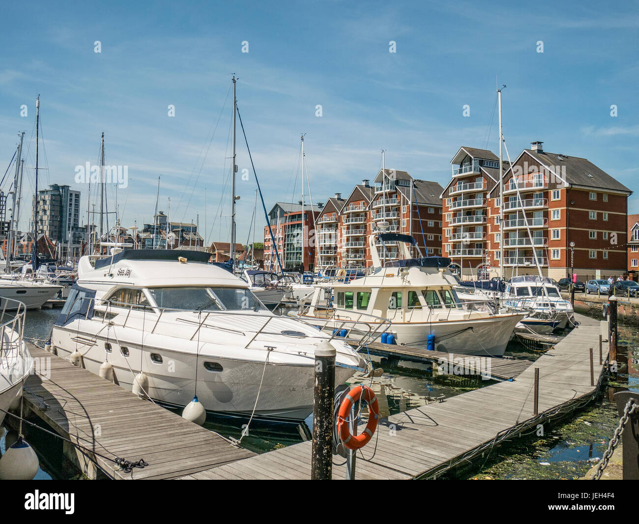 Ipswich Suffolk UK Marina with Residential Apartments Motor Cruisers and Yachts Moored - Stock Image