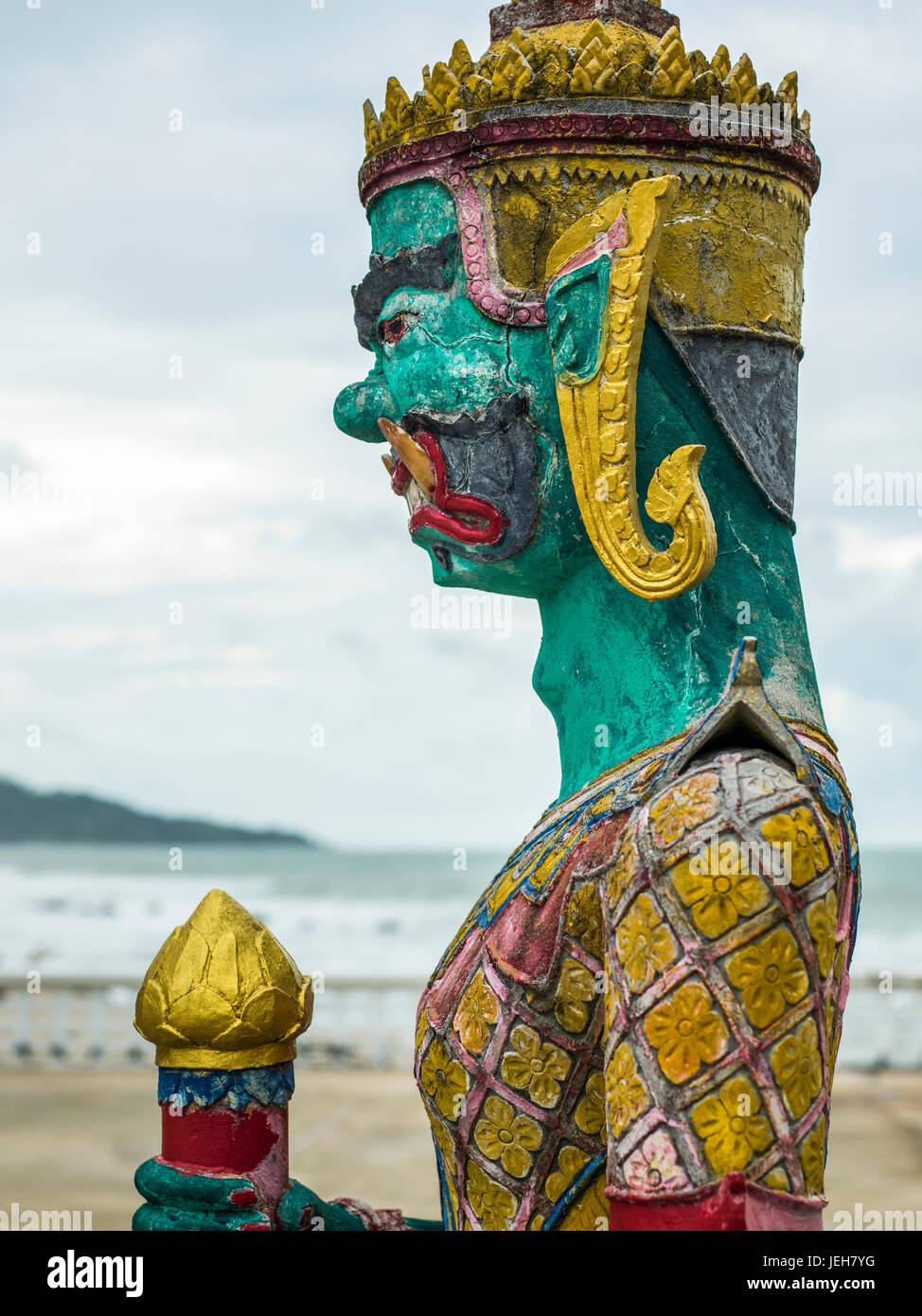 Close-up of a colourful, painted statue and the Gulf of Thailand in the background; Ko Samui, Chang Wat Surat Thani, - Stock Image